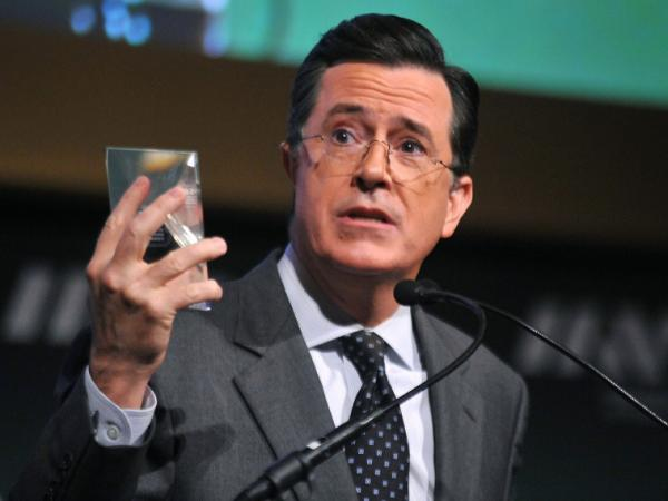 Stephen Colbert, seen here in a file photo from November 2011, postponed production of his Colbert Report due to concerns about his mother's health, according to reports. The show will resume taping Monday, according to Comedy Central.
