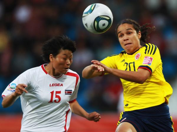 North Korea's Yu Jong Hui (left) and Colombia's Orianica Velasquez battle for the ball during the FIFA Women's World Cup on July 6, 2011, in Bochum, Germany.