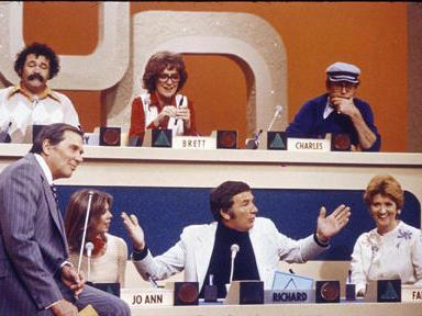 The participants on an early episode of <em>Match Game</em>, including Richard Dawson in the lower center position.