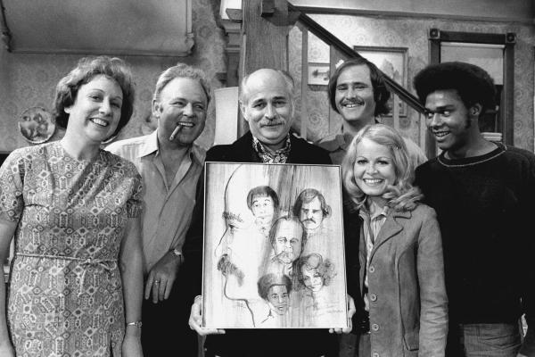 Norman Lear (center) created, developed and produced the hit show <em>All in the Family</em>, which ran from 1971 to 1979. The politically charged sitcom starred Jean Stapleton, Carroll O'Connor, Rob Reiner, Sally Struthers and Mike Evans.