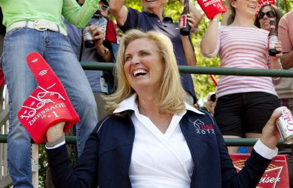 "Ann Romney wears a ""Dressage is no. 1"" foam finger at a qualifying round in June."