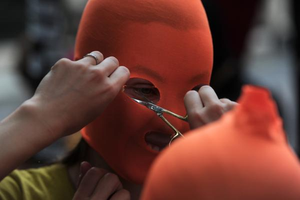 Pussy Riot supporters make masks near the Russian Embassy in London.