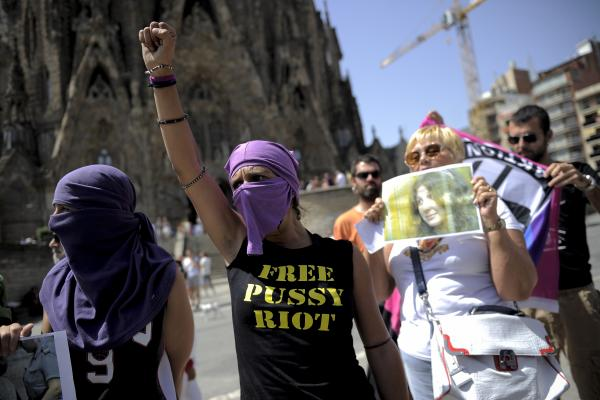 Demonstrators gather near the Sagrada Familia, a Catholic church in Barcelona, Spain.