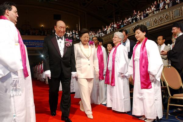 Moon and his wife are introduced during the Affirmation of Vows part of the Interreligious and International Couple's Blessing and Rededication Ceremony, 2002, at New York's Manhattan Center. Some 500 to 600 couples participated in the New York ceremony, and an estimated 21 million couples participated worldwide via a simulcast to 185 countries.