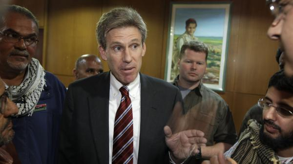 U.S. Ambassador Chris Stevens worked closely with Libya's rebels last year when they overthrew Moammar Gadhafi. He's shown here speaking to journalists in Benghazi last April.