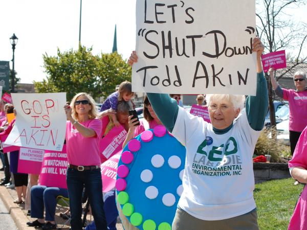 Planned Parenthood organized a protest outside a fundraiser for Todd Akin on Monday.