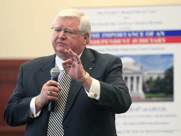 Speaking at the University of Florida in Gainesville, state Supreme Court Justice Fred Lewis said Florida's courts should be independent. Lewis is one of three justices fighting to keep his seat.