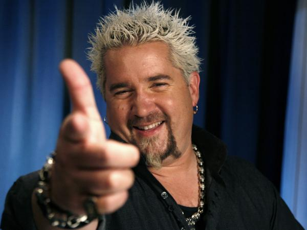 Food Network star Guy Fieri just opened a new restaurant in Times Square. <em>New York Times</em> restaurant critic Pete Wells isn't a fan, so why did he eat there in the first place?