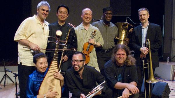 <em>Burning Bridge</em> personnel, left to right: Jason Kao Hwang (violin), Wang Guowei (erhu), Sun Li (pipa), Ken Filiano (string bass), Andrew Drury (drum set), Joseph Daley (tuba), Steve Swell (trombone), Taylor Ho Bynum (cornet/flugelhorn).
