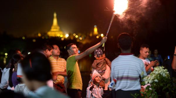 Revelers count down to 2013 near the Shwedagon Pagoda in Yangon, Myanmar, where thousands gathered for the city's first public countdown to the New Year.