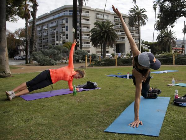 City officials say Palisades Park in Santa Monica, Calif., is being overrun by people participating in fitness training, including boot camps, yoga classes and massage therapy sessions.