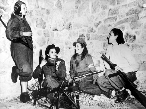 Female Italian partisans in Castelluccio, Italy, keep weapons ready as they wait for their turn to patrol with the U.S. 5th Army on Feb. 11, 1944.