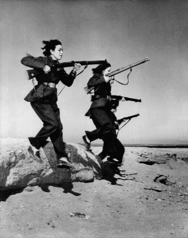 "Female members of Egypt's ""liberation battalions"" train in the desert near Cairo for guerrilla warfare against the British in the Suez Canal zone on Nov. 20, 1951."
