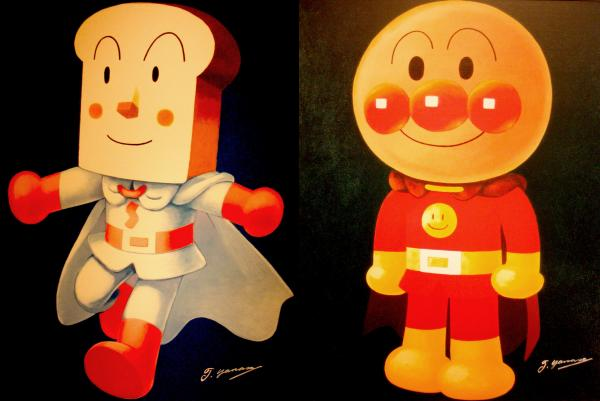 Two of the heroes from the anime series <em>Go! Anpanman</em>. The head of Shokupanman (left) is made out of white bread. Anpanman (right) is named after a Japanese sweet roll stuffed with red bean paste.