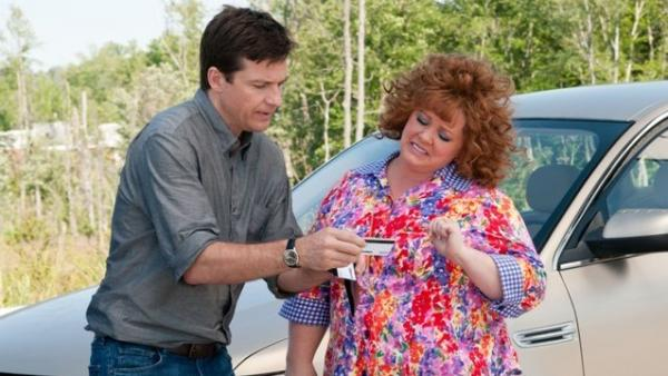 An overextended Sandy (Jason Bateman) must prevent the raunchy Diana (Melissa McCarthy) from continuing to use his identity as a financial crutch in <em>Identity Thief.</em>