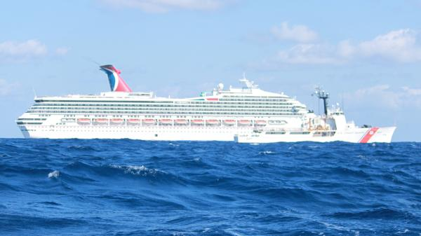 The Carnival cruise ship Triumph drifts in the Gulf of Mexico Monday, before the arrival of tugs that are now towing it to Mobile. The ship is expected to arrive Thursday night.