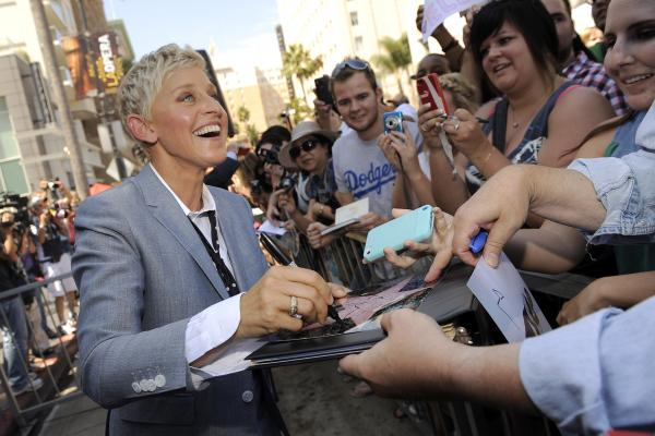 DeGeneres signs autographs following her Hollywood Walk of Fame star ceremony on Sept. 4, 2012, in Los Angeles.