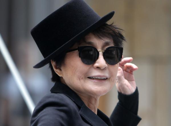 "Yoko Ono poses during the opening of her exhibition ""half-a-wind show"" in Frankfurt, Germany."