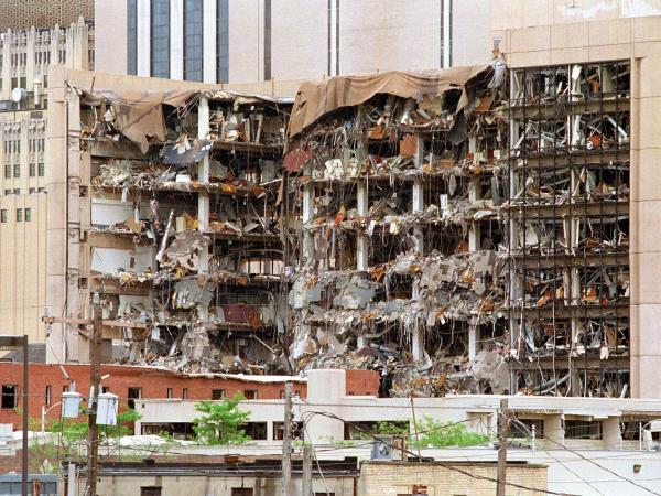 <strong>Oklahoma City Bombing:</strong> The Albert P. Murrah Federal Building shows the devastation caused by a fuel and fertilizer truck bomb on April 19, 1995. The blast killed 168 people and injured more than 500.