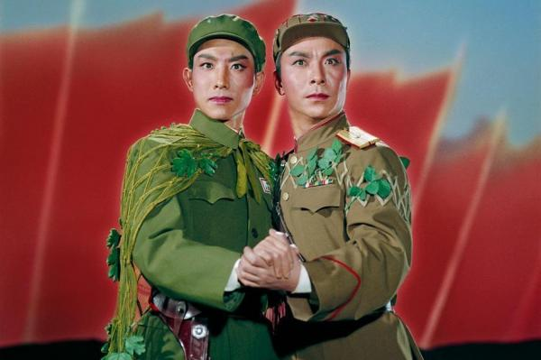"Photographer Zhang Yaxin created incredible and indelible images as stills from the array of ""model"" operas and ballets planned and sanctioned by the Chinese government during the Cultural Revolution.A Chinese and North Korean solider embrace in <em>Raid on the White Tiger Regiment</em>, 1971."