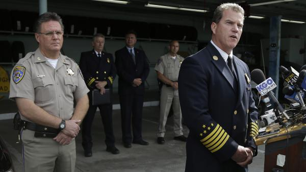 Investigators are trying to determine why the a limousine burst into flames on a San Francisco Bay bridge, trapping and killing five of the nine passengers late Saturday night. Foster City Fire Department Chief Michael Keefe, right, speaks as Redwood City California Highway Patrol Commander Mike Maskarich stands by Monday.