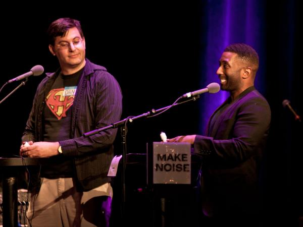 Film critic Wesley Morris (right) faces off against a fellow movie buff in front of a crowd at the Wilbur Theatre in Boston.