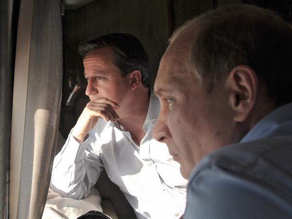 British Prime Minister David Cameron (left) and Russian President Vladimir Putin viewed the Sochi Olympic Park along the Black Sea coast by helicopter Friday.