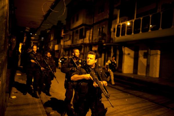 Rio de Janeiro's Elite Special Forces Police Unit patrols the Caju <em>favela</em> complex as part of the pacification program designed to crack down on crime in advance of the World Cup in 2014 and the Summer Olympics in 2016.