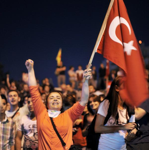 Turkish mothers wave the national flag during a vigil on Friday in memory of those killed during recent demonstrations in Istanbul's Taksim Square.