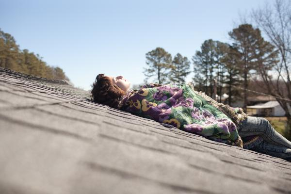 Eden lies on the rooftop of her mother's home to reflect on old times in Lancaster, Va., and contemplate the possibility of going to jail.