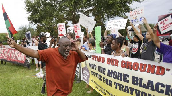 Chimurenqa Waller leads demonstrators in a chant in front of the Seminole County Courthouse while the jury deliberated in the trial of George Zimmerman on Friday