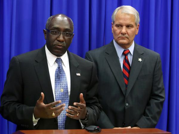Sanford Police Chief Cecil Smith, left, and Seminole County Sheriff Donald Eslinger appealed to the community to react peacefully to the jury's decision.