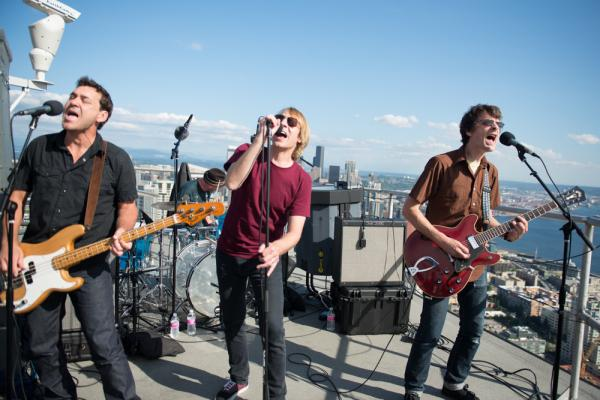 <strong>Touch Me I'm A Local Institution: </strong>Mudhoney plays from more than 500 feet above Seattle, on the roof of the Space Needle, as part of a set celebrating Sub Pop's Silver Jubilee broadcast by KEXP