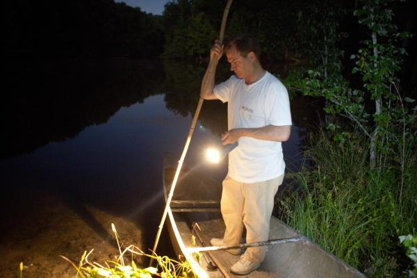 "Tommy Peebles shines a light on the pond. With the help of Bick Boyte, the two Tennesseans catch frogs with homemade ""gigs"" for a frog leg fry they hold every year."