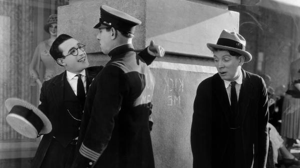 Harold Lloyd (left) is the All-American Boy, a striver who'll brave nearly anything to get to the top and win The Girl. Noah Young is The Law (center) and Bill Strother is The Pal.