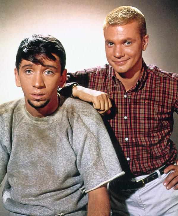 <em>The Many Loves of Dobie Gillis</em> is the first in a straight line of teen comedies from the teen point of view. It starred Dwayne Hickman (right) as Dobie and Bob Denver as his best friend, Maynard.