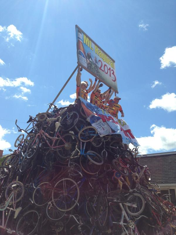 "Mt. Ragbrai: A mountain of bicycles in West Point, IA. On the phenomenon of stretching ""short rides"" across a full day's time (on account of good conversation), one woman smiled and said: ""That's RAGBRAI."""