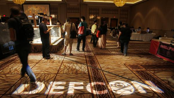 Hackers attend the 2011 Def Con conference in Las Vegas. The 2013 conference as well as the Black Hat hacker conference kicks off this week.