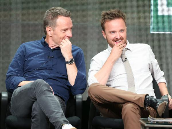 Actors Bryan Cranston and Aaron Paul speak onstage during the <em>Breaking Bad</em> panel on July 26.