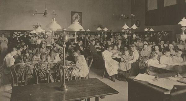 "Patrons in the reading room of the Carnegie Library of Homestead in Munhall, Pa., circa 1900. The Carnegie Steel Co.fought back against striking steel workers in Homestead in 1892. <a href=""http://media.npr.org/assets/img/2013/07/31/15412v_archive.jpg"">Click here</a> to see a larger view of this image."
