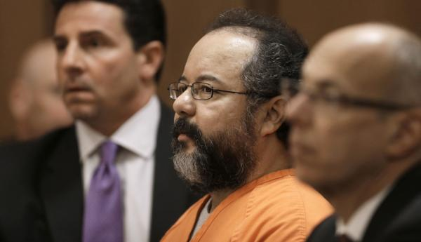 Ariel Castro, center, listens to the judge during court proceedings Friday, July 26, 2013, in Cleveland. (Tony Dejak/AP)