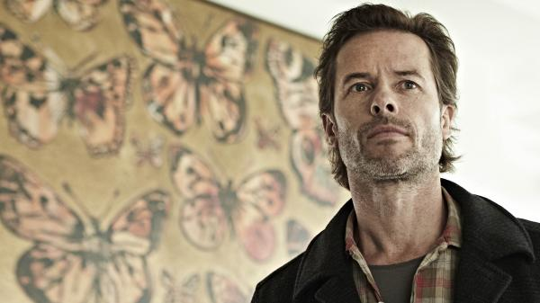Dear Guy Pearce: The <em>Jack Irish </em>stubble is working, though we're not feeling the giant butterfly art. We assume it's in a hoodlum's house, not Jack's, but we'll be watching this weekend just to confirm.