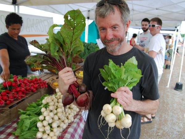Mike Odette, chef and co-owner of Sycamore Restaurant, finds beets and turnips that will make tasty refrigerator pickles at the Columbia, Mo., farmers market.