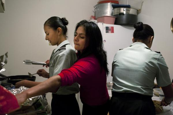 Dinner is family time for Sandra (center) and her daughters Isle (left) and Carina Montes. The family relocated to the U.S. from Mexico when Carina was 2 and Isle was just 5 months old. The girls have been in the Phoenix school system since kindergarten — and are two of an estimated 1.7 million illegal youth living in the United States.