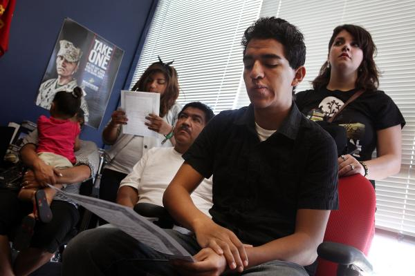 Victor Arriaga and his family wait inside the Marine Corps recruiting office before he starts boot camp. Victor decided to join the Marines in the hopes that he could help bring his mother back from Mexico. She was deported when he was a freshman in high school.