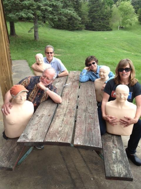Richard Knox, Peter Breslow, Deb Amos and Didi Schanche (l-r) pose with CPR dummies.