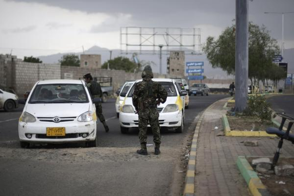 Police stop cars at a checkpoint near the U.S. embassy in Sanaa, Yemen. The State Department today ordered non-essential personnel at the U.S. Embassy in Yemen to leave the country. (Hani Mohammed/AP)