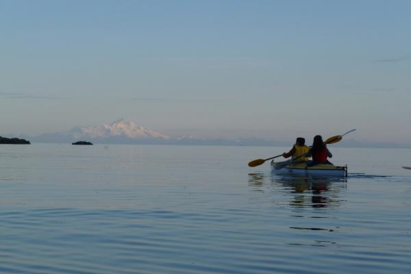 Kathy paddles out onto Tutka Bay in Alaska. (Kathy Gunst/Here & Now)