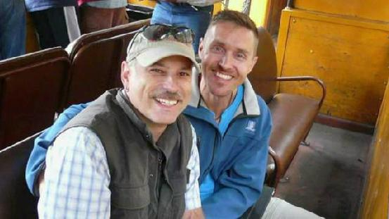 Ron McCoy (left) and Chris Bowers were holding hands after arriving at the Albuquerque, N.M., airport when a shuttle driver told them to move to the back of the bus. The bus company has apologized.