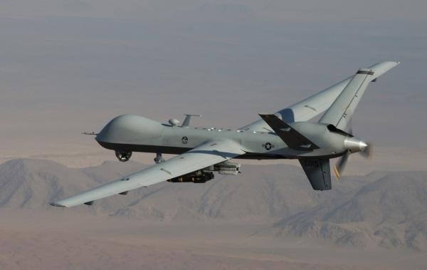 This undated handout photo provided by the U.S. Air Force shows a MQ-9 Reaper, armed with GBU-12 Paveway II laser guided munitions and AGM-114 Hellfire missiles, during a combat mission over southern Afghanistan. (Lt. Col.. Leslie Pratt/U.S. Air Force via AP)